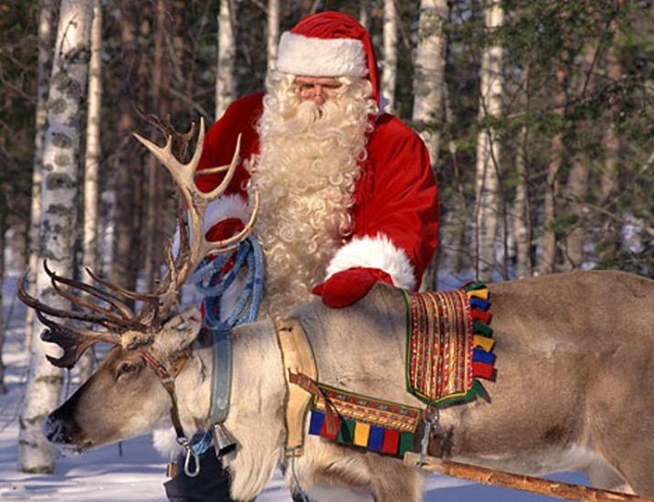 Санта Клаус с оленями
